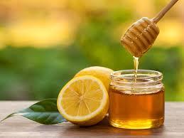 عکس عسل در کنار لیمو- منظور عسل مرکبات است